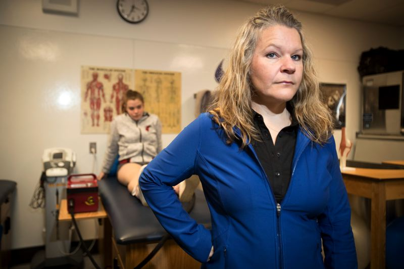 PAMPLIN MEDIA GROUP: JAIME VALDEZ - Shelly Jones, the athletic trainer at Aloha High School in Washington County, says that on some days shes so busy, athletes needing her attention head right to practice rather than wait in line. Most Oregon high schools dont have a full-time trainer.