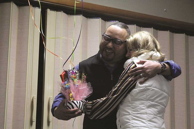 PMG PHOTO: PHIL HAWKINS - Gervais resident Wesley Leiva hugs former Woodburn Area Chamber of Commerce President Liz Koncil after being selected as Junior First Citizen for the 2019 DSA Awards