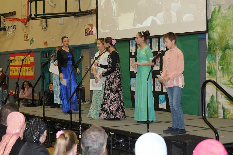 PMG PHOTO: JUSTIN MUCH - Students from the dual-language Heritage Elementary and Valor Middle schools entertain visitors to the Russian Festival on Thursday, Feb. 7.