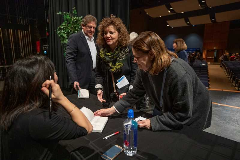 REVIEW PHOTO: JONATHAN HOUSE - Kik Nielsen (center) and Katherine Purtzer (right) get their books signed by author Cristina Henriquez after her Lake Oswego Reads presentation on Feb. 13.