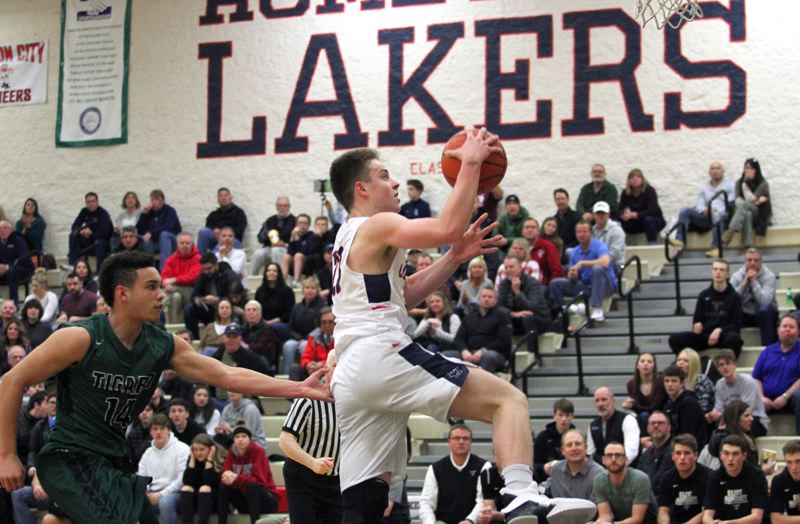 REVIEW PHOTO: MILES VANCE - Lake Oswego's Josh Angle goes up to score during the first half of his team's 61-46 home win over Tigard on Friday night.