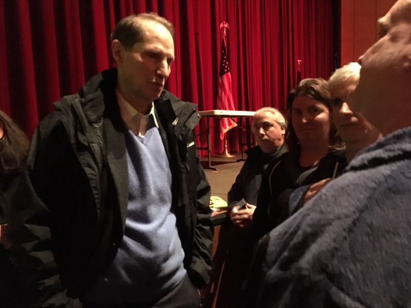 TIMES PHOTO: PETER WONG - U.S. Sen. Ron Wyden, D-Ore., meets a constituent after a town hall meeting Friday night, Feb. 15, at the Sylvania campus of Portland Community College.