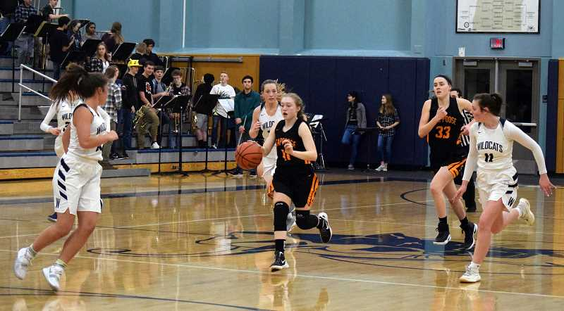 SPOKESMAN PHOTO: TANNER RUSS - Scappoose's Sierra Stafford charges down the court against the Wildcats late in the fourth quarter.