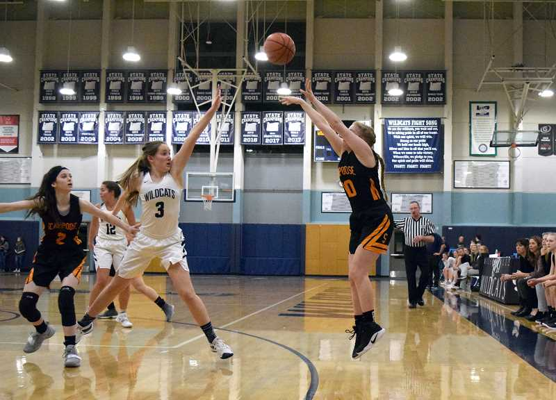 SPOKESMAN PHOTO: TANNER RUSS - Scappoose's Sarah Mills takes a shot from beyond the arc. The Indians 3-point game was strong in the second half of the game, producing 12 points on outside baskets.