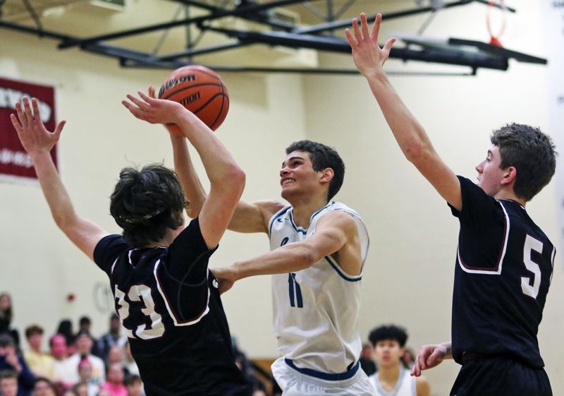 TIMES PHOTO: DAN BROOD - Century junior Chance Sparks (center) drives to the basket during Friday's Pacific Conference  contest with Sherwood.