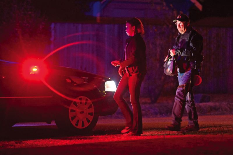 FILE PHOTO - Officer Jim Petersen takes a person into custody while patrolling hot spots in East Portland.