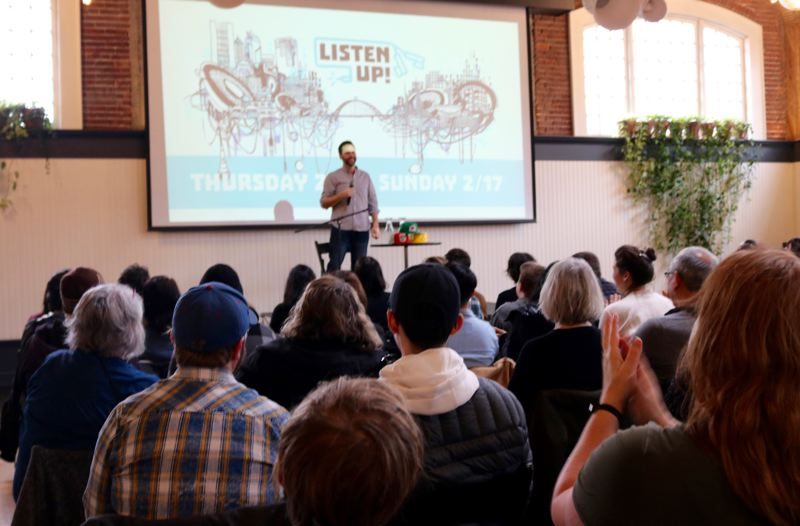TRIBUNE PHOTO: ZANE SPARLING - Dan Pashman of The Sporkful greets the crowd at The Evergreen venue on Saturday, Feb. 16, during the Listen Up! podcast festival in Portland.