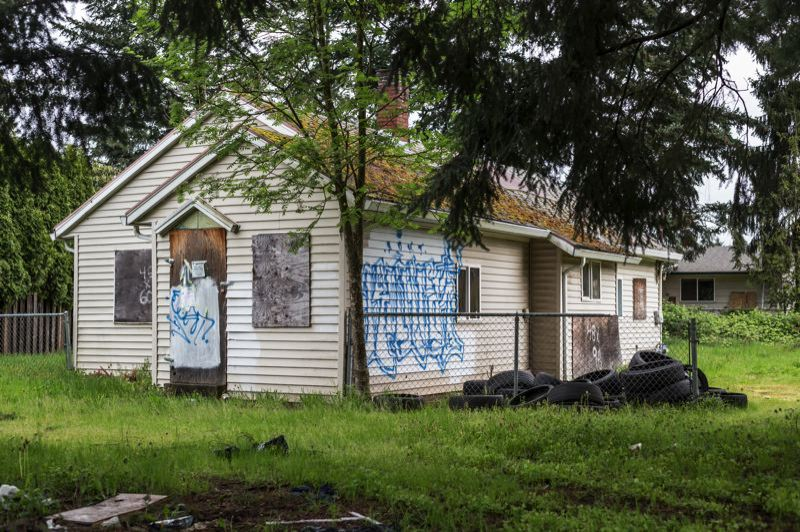 PORTLAND TRIBUNE: JONATHAN HOUSE - A 'zombie home' in Southeast Portland that took many years for the City Council to approve for foreclosure. It has since been demolished.