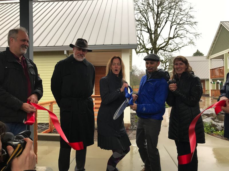 COURTESY: GREEN HAMMER - Vassar Byrd, second from left, the executive director of Rose Villa Senior Living, and Stephen Aiguier, third from left, founder and president of Green Hammer, prepare to cut the ribbon during the Feb. 12 grand opening of The Oaks, a net-zero community for seniors.