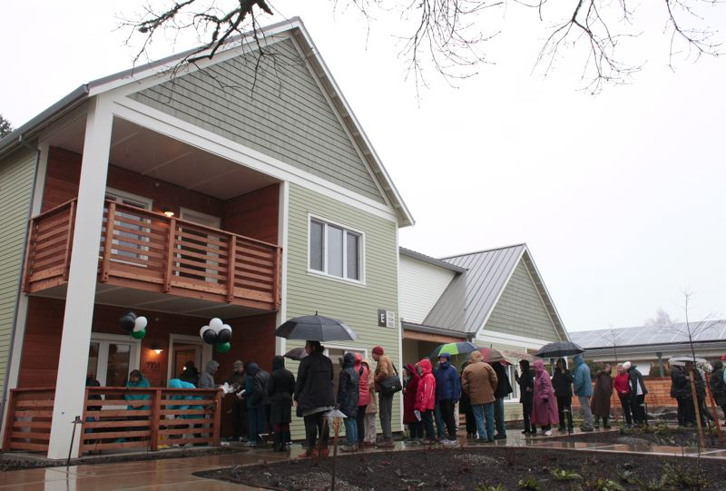 COURTESY: GREEN HAMMER - Visitors to a Feb. 12 grand opening line up outside The Oaks, a new net-zerio senior living community at Rose Villa.