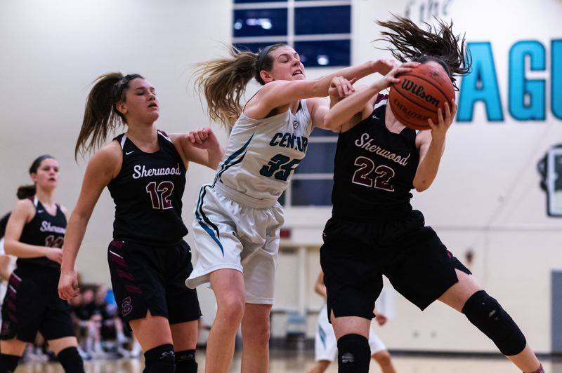 PMG PHOTO: CHRIS OERTELL - Sherwood High School junior Julia Leitzinger (22) tries to keep the ball away from Century senior Gavyn Shaefer during the Pacific Conference game.