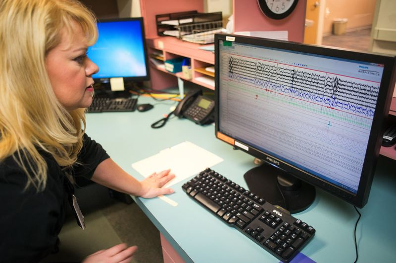 FILE PHOTO - Julie Goodrich, a registered polysomnographer, watches a heart rate monitor during a sleep study on Tuality Healthcare's campus in Forest Grove in 2014. Tuality has expanded its Forest Grove presence, taking over the Maple Street Clinic next to its existing urgent care center.