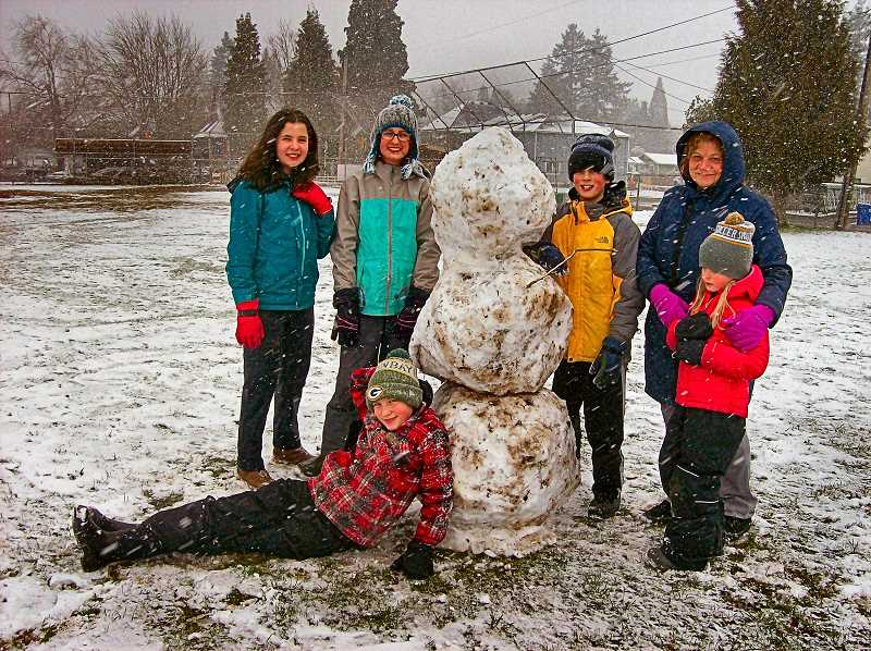 RITA A. LEONARD - Friends build snowmen on the Lewis School playground: Isadora, Milla, Marco, Logan - and Idelia, with her Gramma Karen Park - as the snowflakes were still flying.