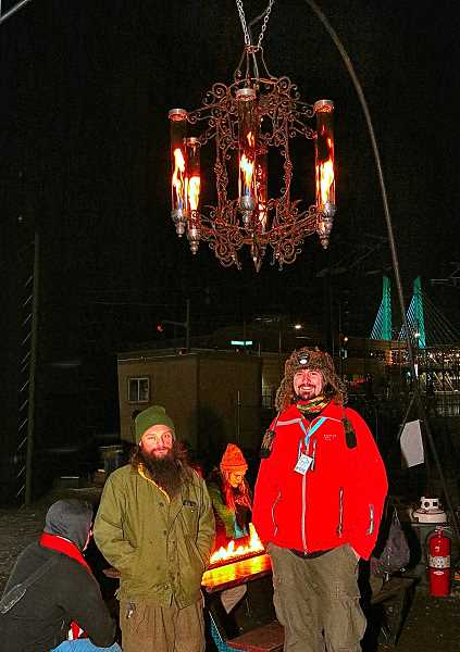 DAVID F. ASHTON - Chris LohKamp, a mentor of Southeast Portlands Metal Beavers FIRST Robotics Team #1432, and partner Ryan Ramage, proudly show off their Dragon Twist Chandelier - which has been featured at Burning Man.