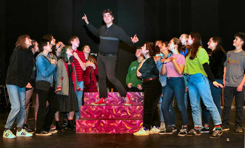 DAVID F. ASHTON - Rehearsing for the Franklin High production of Bye Bye Birdie, opening in early March, senior Jonas Boone towers over his adoring fans as he portrays rock-and-roll star Conrad Birdie.