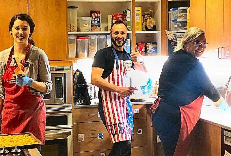 The nonprofit Ronald McDonald House provides quarters for families whose children are in the hospital, and periodically John L. Scott Woodstock realtors volunteer to fix meals for them.