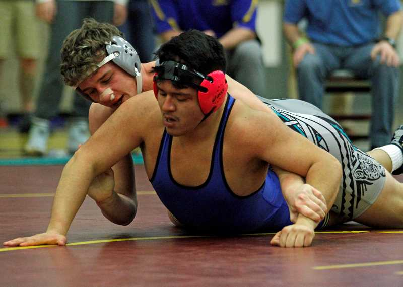 STAFF PHOTO: WADE EVANSON - Century's Loudyn Reese wrestles during his semi-final match at the Pacific Conference District Championships, Feb. 15-16, at Forest Grove High School. Reese won the 195 pound division.