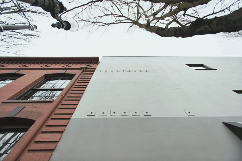 PORTLAND TRIBUNE: JAIME VALDEZ - Among other upgrades, the Rejuvenation Hardware building was bolted to a newer concrete building next door. The visible bolts on that building support steel beams that extends into the 1905 masonry building.