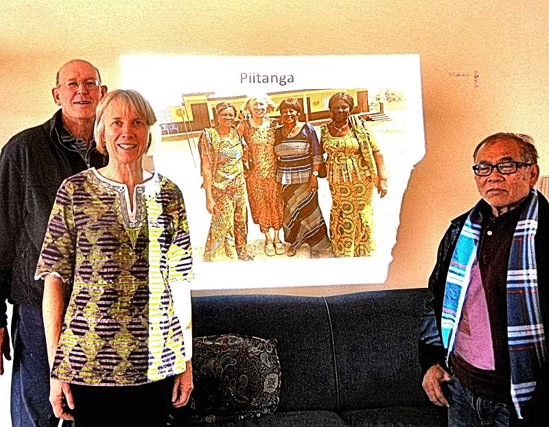 ELIZABETH USSHER GROFF - David Stone, Lisa Revell, and Chareundi Van-Si are shown standing in front of a slide showing Revell, the headmistress, and two teachers at a school in Ghana built by non-profit Framework International. The organization was started by a Linfield College student, after his month-long trip to Ghana.