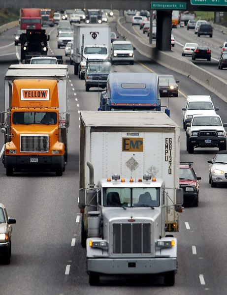 FILE PHOTO - Semi-trucks and passenger vehicles compete for space in Portland.
