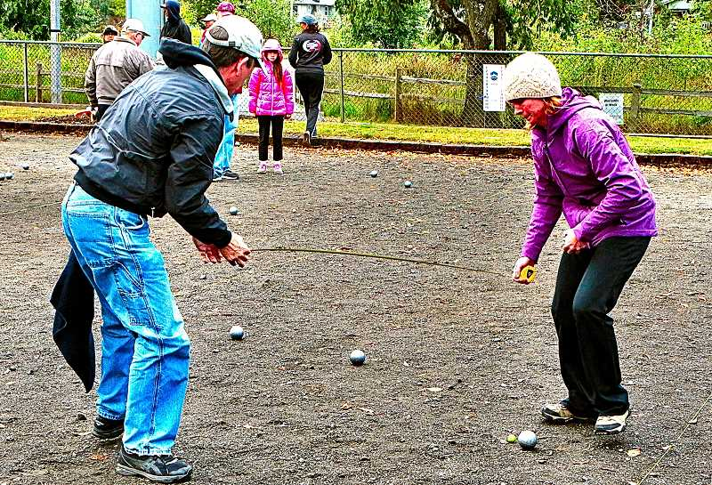 DAVID F. ASHTON - Players used a measuring tape to settle which boule was closest to the cochonnet.