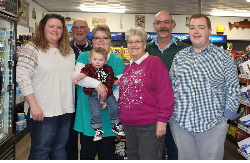 HOLLY SCHOLZ/CENTRAL OREGONIAN  - The Hodnett family is celebrating their 20th year as owners of R&R Grocery and Sporting Goods, a convenience store on Combs Flat Road. Pictured left to right, Karlee Klein, Sid Carter, Tina Hodnett holding her grandson Karter Klein, Louise Carter, Ed Hodnett and Kyle Hodnett.