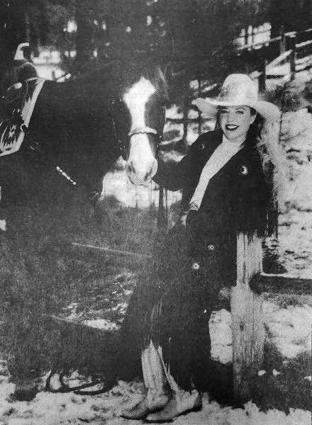 CENTRAL OREGONIAN FILE PHOTO  - Feb. 17, 1994: Kitty Sharp, pictured with One Tough Doll, has spent nearly her whole life competing in rodeos all around Oregon. She was crowned Miss Rodeo Oregon Feb. 12.