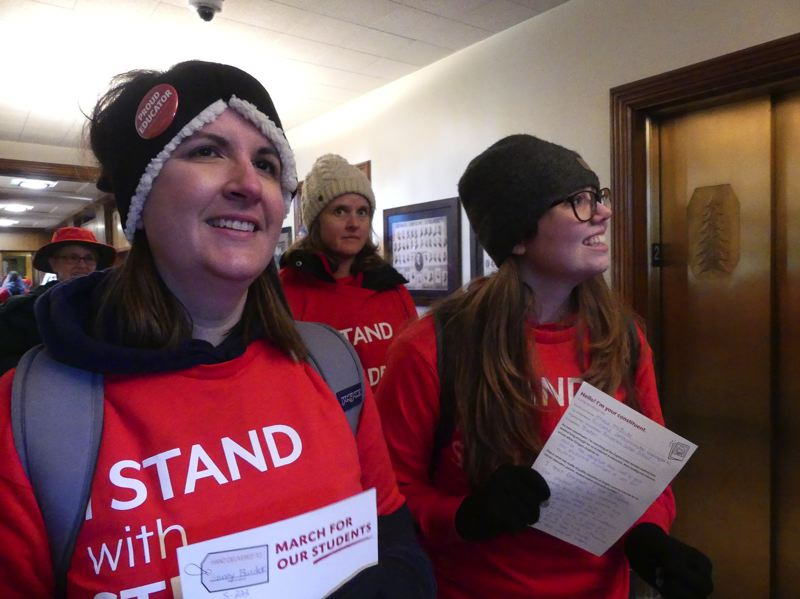 COURTESY PHOTO: RACHEL ALEXANDER/OREGON CAPITAL BUREAU - Local teachers Katie Lukins of Bethany Elementary School, left, and Jessica McBride of Bonny Slope Elementary School, delivered messages Monday, Feb. 18, to Oregon Senate offices after the March for our Students in front of the Capitol.