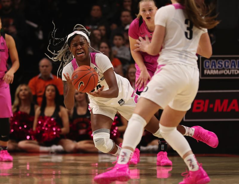 TRIBUNE PHOTO: JAIME VALDEZ - Oregon standout Ruthy Hebard grimaces as she suffers a leg injury in the first half Monday at Gill Coliseum.