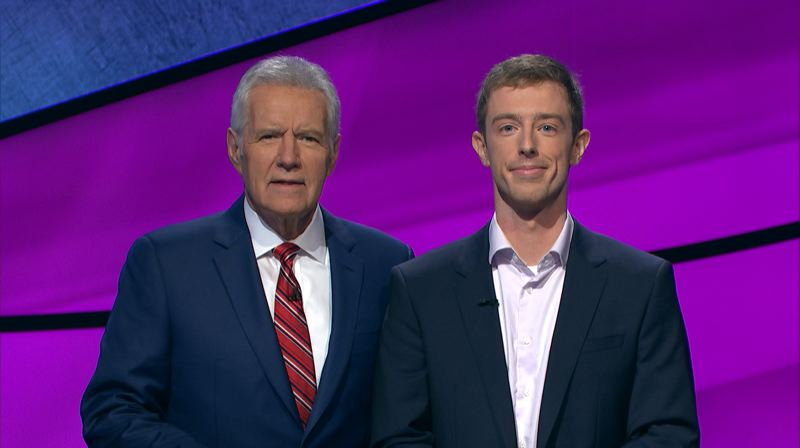 COURTESY: JEOPARDY PRODUCTIONS, INC. - Portland's Bif Reiser (right), standing with host Alex Trebek, was a three-night winner on 'Jeopardy!'
