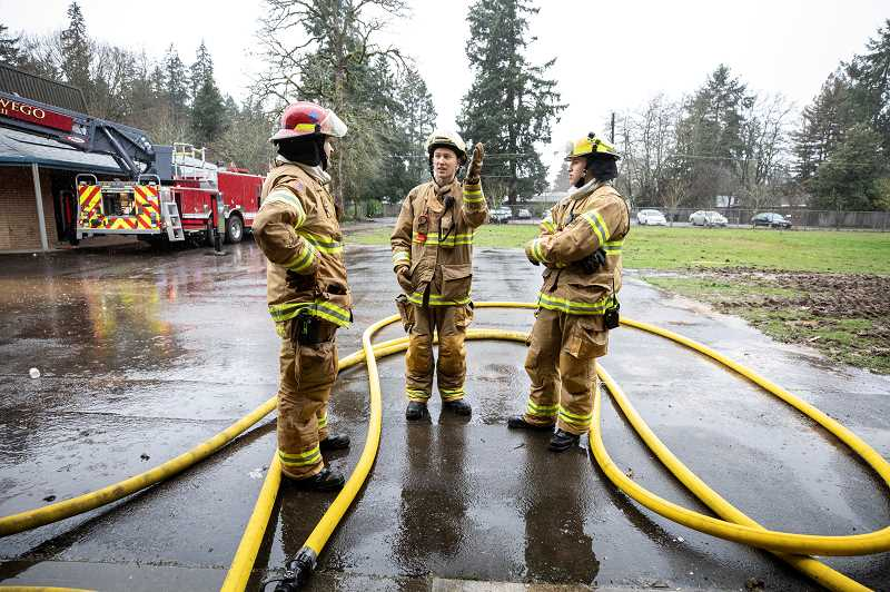 REVIEW PHOTOS: JONATHAN HOUSE - LOFD firefighter Andrew Fox (center) goes over rescue techniques during training at the old Bryant Elementary School building.