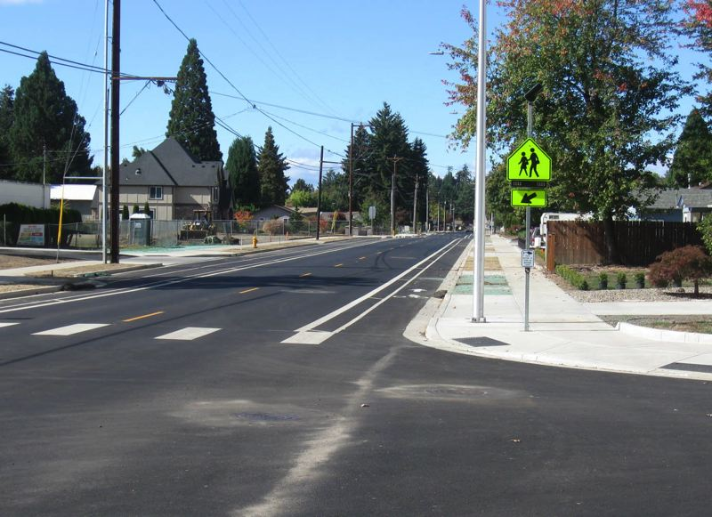 COURTESY PHOTO - When finished, Golden Road will look much like Cedar Street, which also received street improvements including added sidewalks and bike lanes.
