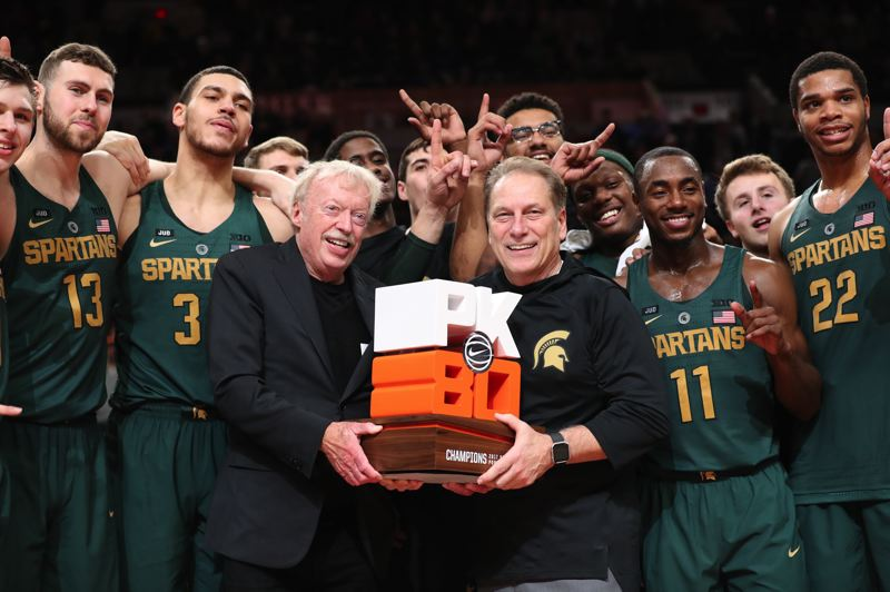 TRIBUNE FILE PHOTO: JAIME VALDEZ - Phil Knight joins coach Tom Izzo and the Michigan State Spartans at PK80 in Moda Center.