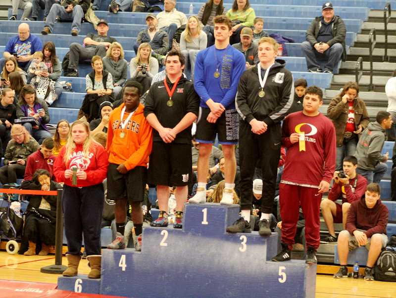 STEELE HAUGEN - Bailey Dennis stands on the podium after placing sixth at the district tournament held in Madras on Feb. 8-9. She wrestled all boys to get ready for the girls state tournament.