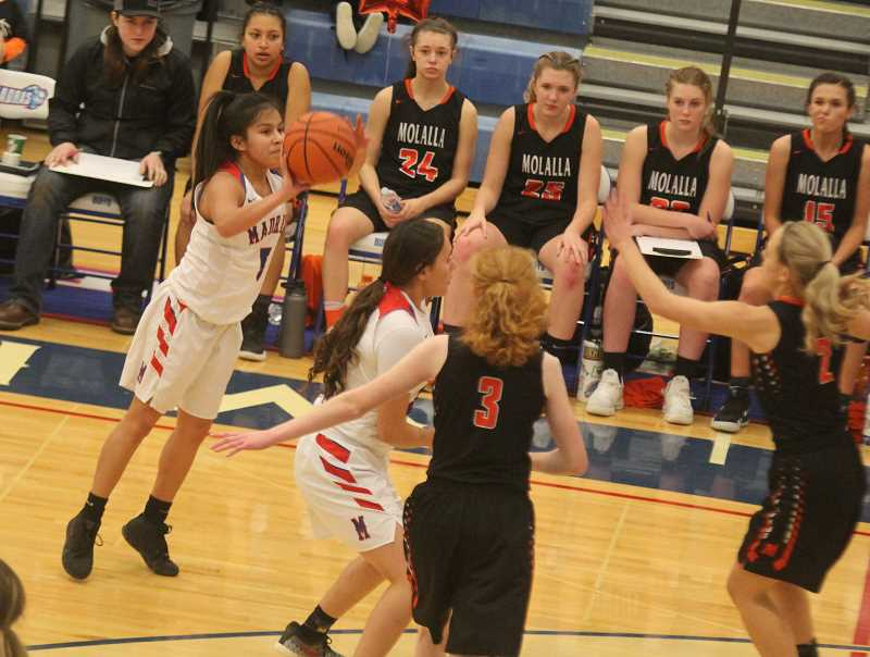 STEELE HAUGEN - Senior Vanessa Culps hits a clutch 3-pointer in the fourth quarter to help the Lady buffs beat the Molalla Indians on senior night.