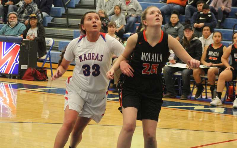 STEELE HAUGEN - DaRia White, 33, moves in to grab an offensive rebound on a free throw and works hard in the post for an And-1.