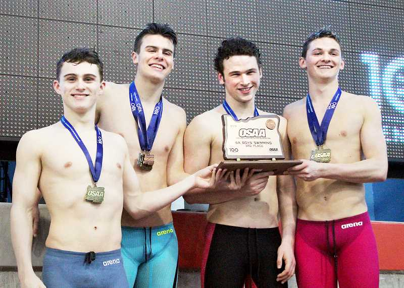 PHOTO COURTESY OF MELISSA PATTERSON  - (From left): Ty Patterson, Trey Fincher, Elijah Clements, Zach Jordan celebrate the Tigers' third-place showing at the state swimming championships.