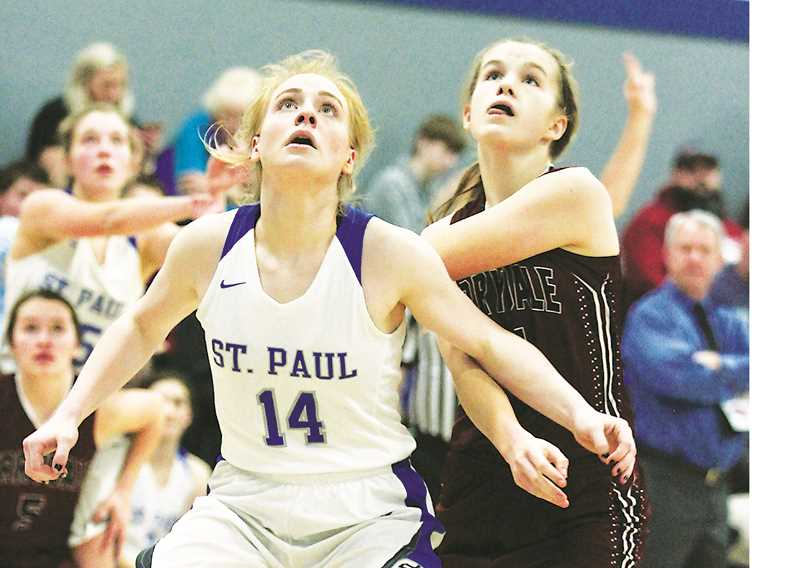 PHIL HAWKINS -- WOODBURN INDEPENDENT - Junior Isabelle Wyss maneuvers for a rebound in Saturday's St. Paul win over Perrydale.