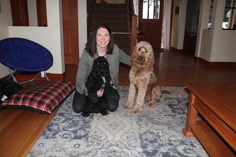 PMG PHOTO: JUSTIN MUCH - Roughly two years ago Melinda Hammelman, shown here with Winston, left, and Maggie, traded in her career as a court clerk so she could take care of dogs, a gig shes been grooming for all her life.