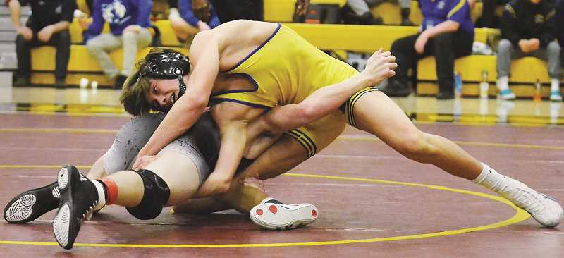 GARY ALLEN - Freshman Charlie Evans contorts his body in a victory at 132 pounds in the Pacific Conference district championships on Saturday.