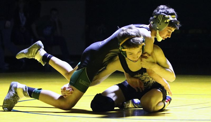 PAMPLIN MEDIA GROUP PHOTO: JIM BESEDA - West Linn's Ricky Bell (top) battles teammate Jordy Tawa in their championship match at 106 pounds during the Three Rivers League district wrestling tournament at West Linn High School on Saturday night.