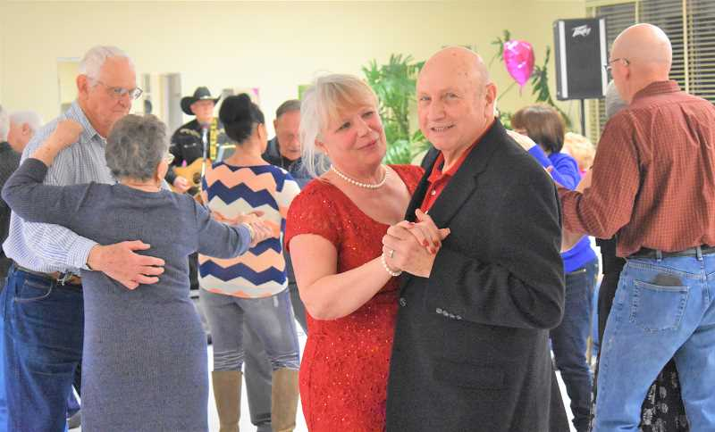 ESTACADA NEWS PHOTO: EMILY LINDSTRAND - Julie Caruthers and Ron Hubbard dance at their wedding reception at the Estacada Community Center last weekend.