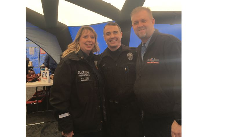 PHOTO COURTESY CLACKAMAS FIRE - Community paramedic AmyJo Cook of Clackamas Fire invited Mike Day, the Oregon City Police Department's homeless liaison officer, center, and Dan Hall of American Medical Response to the Feb. 6 Resource Fair at Barclay Park in Oregon City.