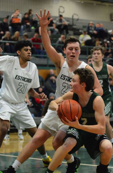 ESTACADA NEWS: DAVID BALL - Estacadas Cody Syring stops a baseline drive by North Marions Brady Hansen during the second half of Wednesdays 60-55 loss to the Huskies.