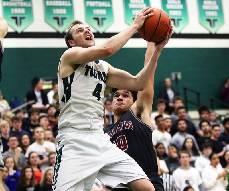 TIMES PHOTO: DAN BROOD - Tigard senior Stevie Schlabach looks to go up to the basket during the Tigers' game with Tualatin on Tuesday.