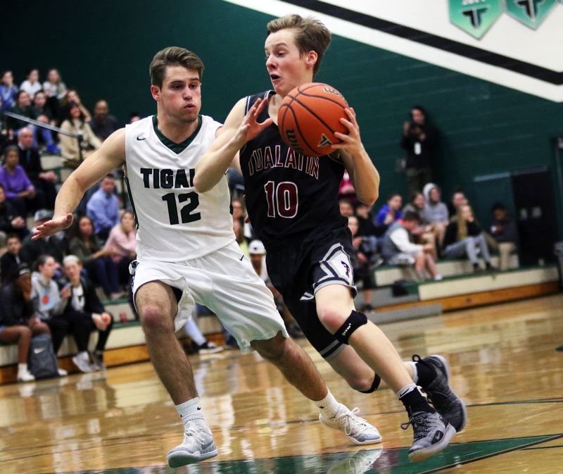 TIMES PHOTO: DAN BROOD - Tualatin senior Derek Leneve (10) looks to drive to the basket during the Wolves' win at Tigard on Tuesday.