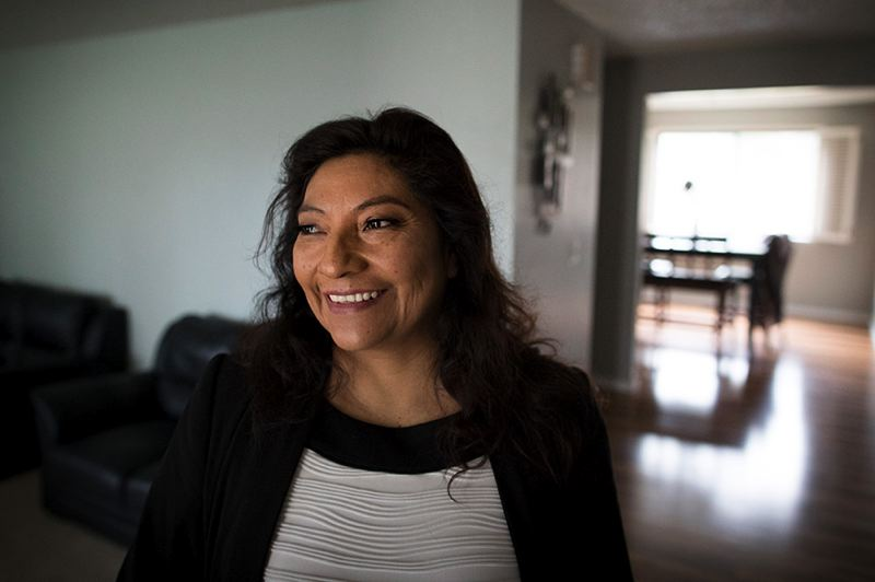TRIBUNE PHOTO: JAIME VALDEZ - Latina immigrant Jenny Soriano saved up money for a down payment for 19 years. She finally was able to move into her own home in HIllsboro in December 2017, along with eight other members of her extended family.