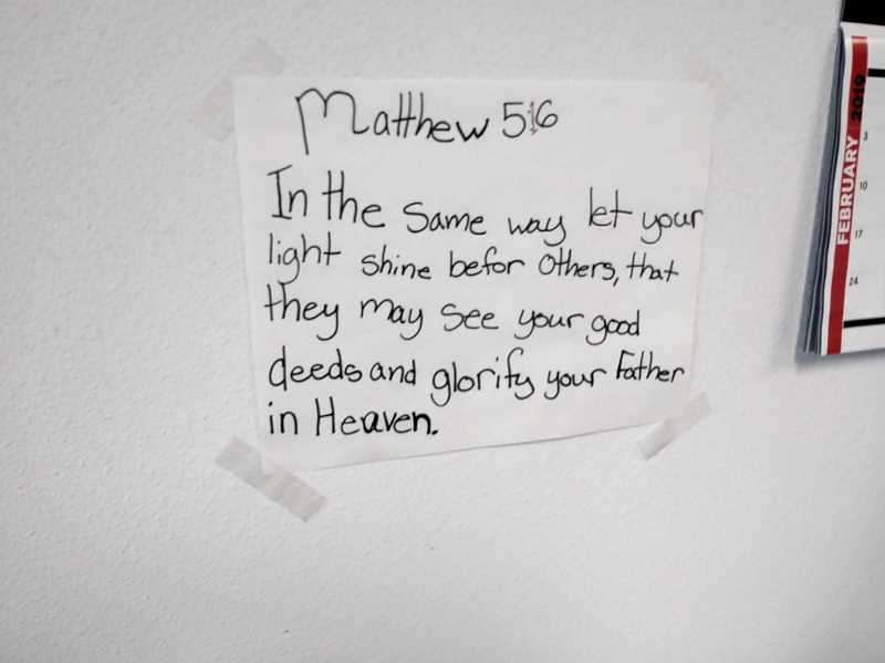 PMG PHOTO: JUSTIN MUCH - Woodburn Automotive proprietor Richard Edmonds keeps a biblical verse shared with him by his granddaughter taped up on the wall of his office. The verse was also etched on the side of a van Edmonds and his wife, Mary, donated to Peoples Church Food Share.