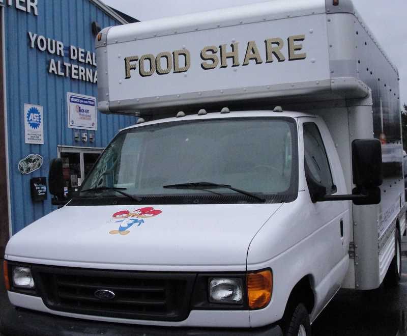 COURTESY OF WOODBURN AUTOMOTIVE - A three-headed woodpecker was among the etchings Woodburn Automotive owner Richard Edmonds put on a van donated to the Peoples Church Food Share.