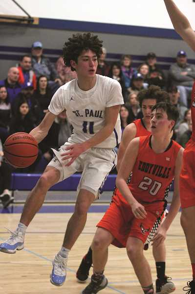 PMG PHOTO: PHIL HAWKINS - St. Paul senior Jaidyn Jackson scored all 16 of his points in the paint against Eddyville, helping the Buckaroos pick up their first home state playoff game in school history.